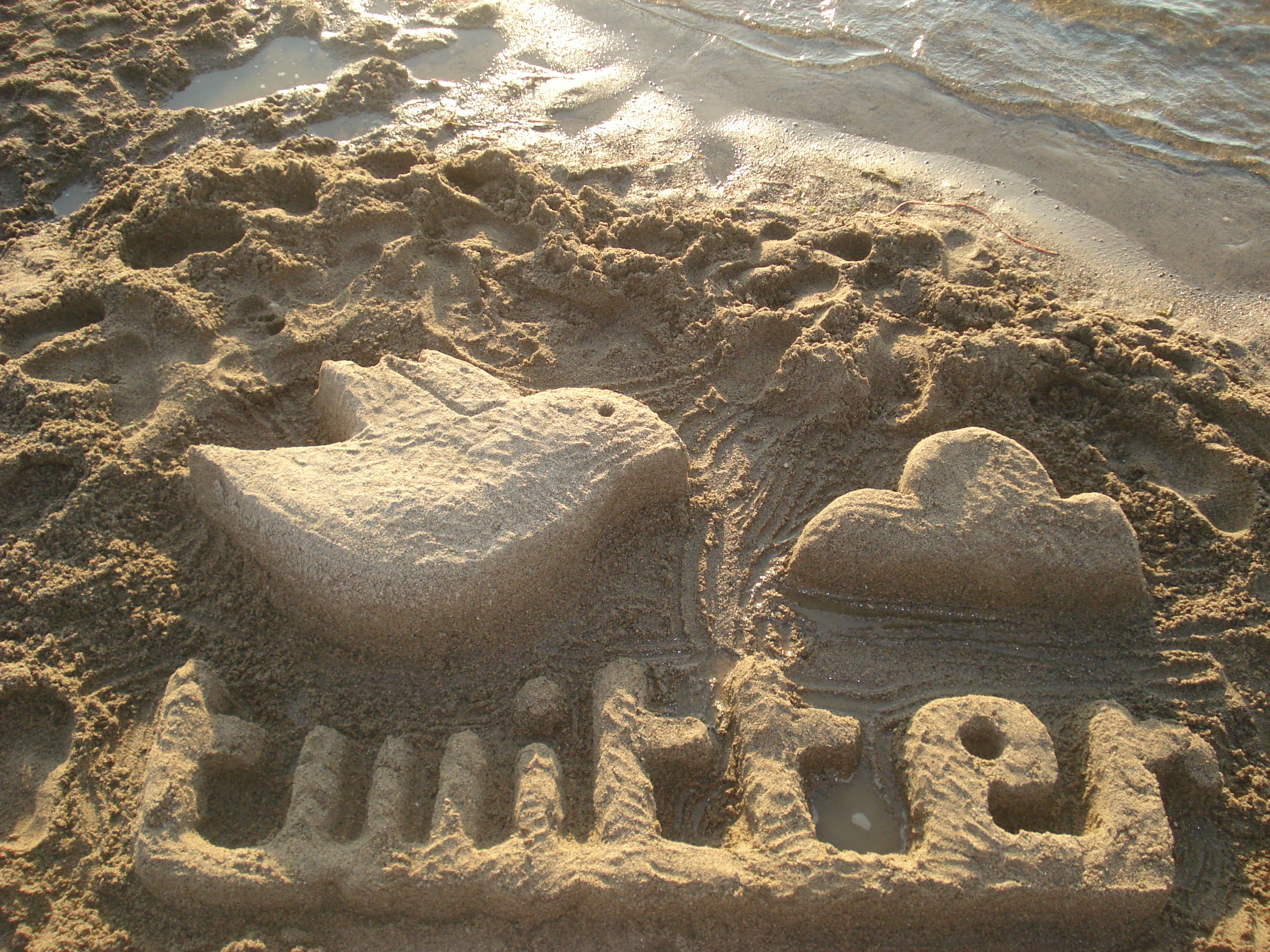 Twitter sand sculpture