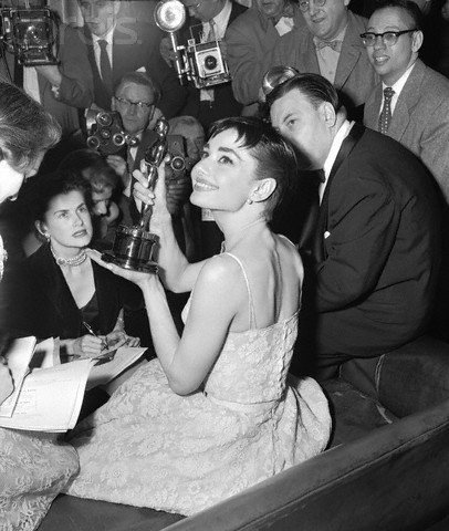 Audrey Hepburn Showing Oscar to Reporters