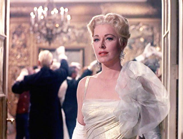 Baroness Schraeder in gold dress