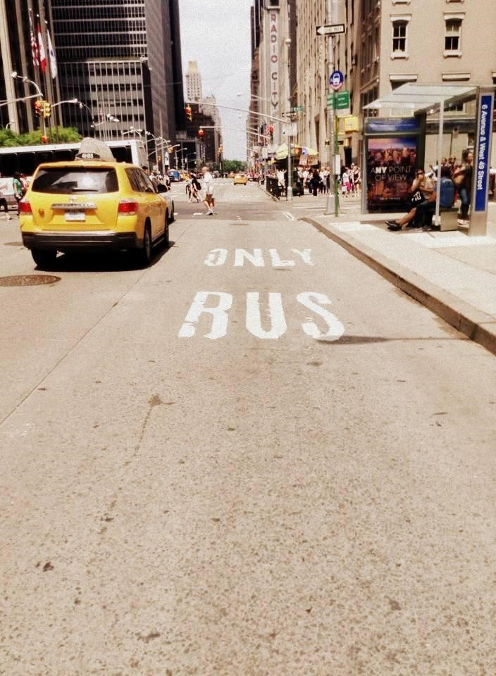 Bus lanes can only be shared by bicycles during evenings and weekends in NYC.
